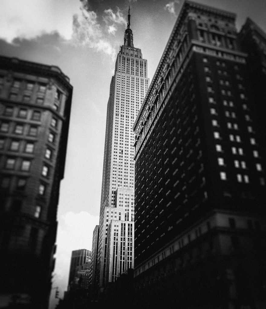 grayscale low angle photo of high rise buildings