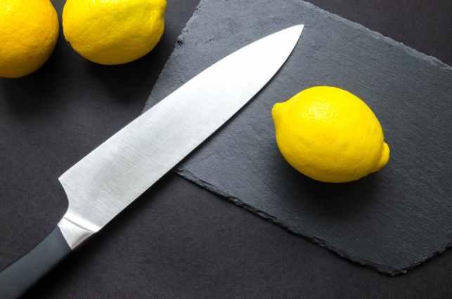 photography of lemon near kitchen knife