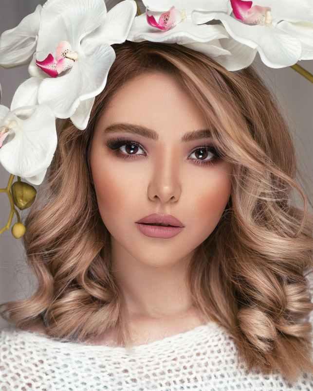 portrait photo of woman wearing flower crown