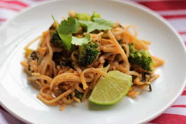 Tofu Pad Thai on a white plate with a fork and lime wedge