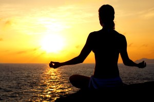 bigstockphoto_Meditating_By_The_Sea_1059748