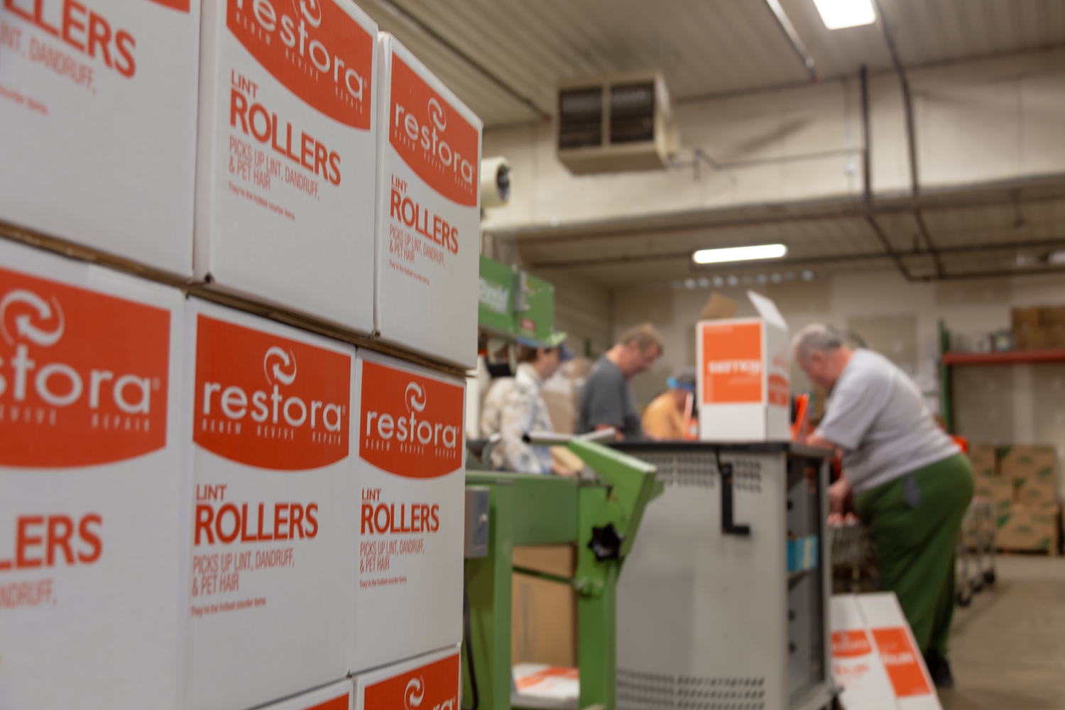 Boxes of repackaged Restora Lint Rollers at Alternatives Industry.