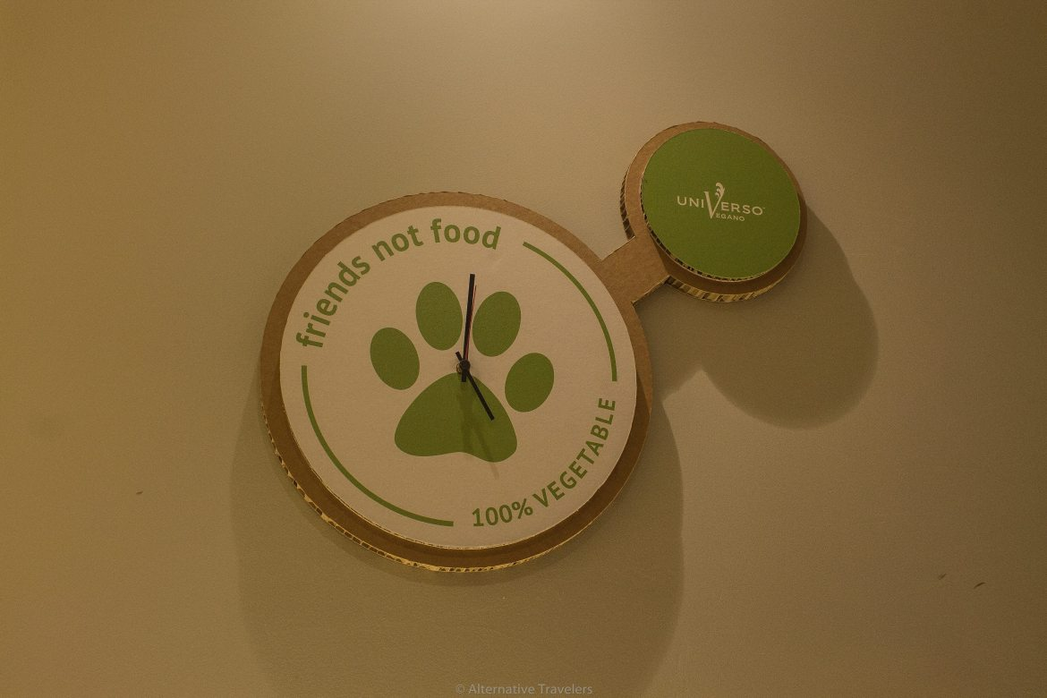 "Clock saying ""Friends not food"" at Universo Vegano, a vegan restaurant in Florence"