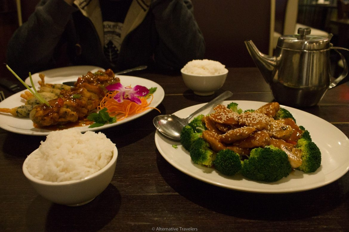 Dragon roll and sesame chicken at Green Zenphony, one of the all vegan restaurants in Queens | AlternativeTravelers.com