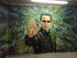 Mur peint par JimmyC représentant Néo dans Matrix - Exposition street art Les Capucines de l'art