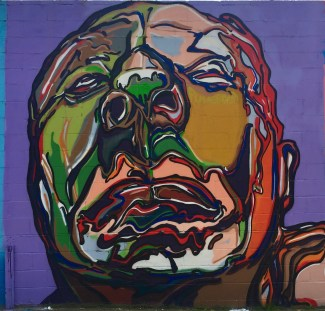 Visage peint réalisé par le Street Artiste Fumeroism pour le Welling Court Mural Project dans le Queens