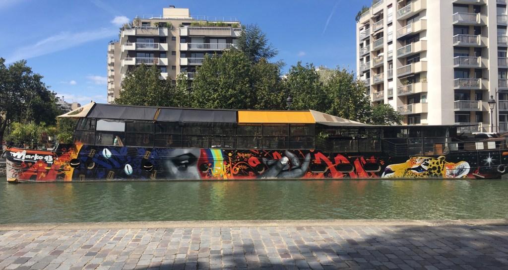 Street Art Canal de l'Ourcq - Sarah la charmeuse de jaguar par Marko 93 - peinture sur péniche