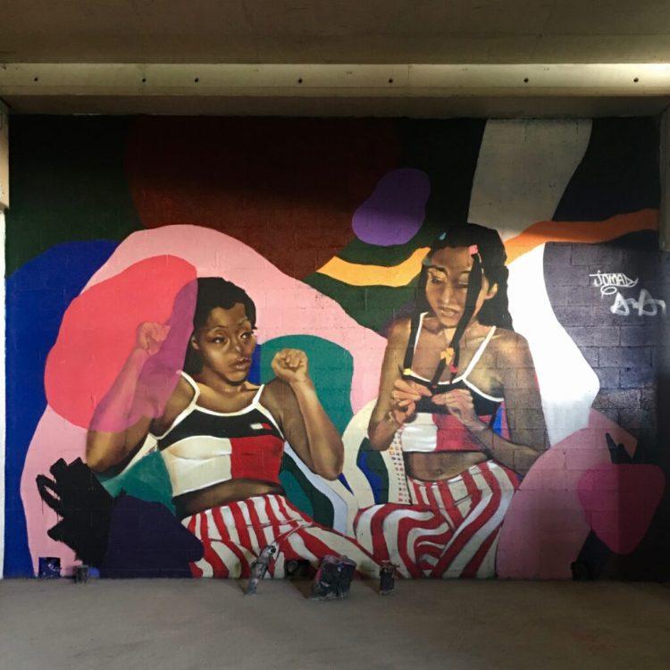 Fresque murale réalisée par les artistes Jomad & Andrew Agustos à Paris