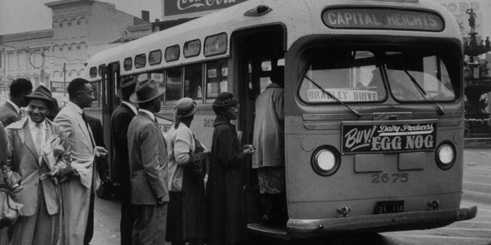 African Americans boarding an integrated _ bus boycott