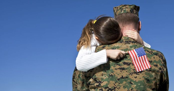 Soldier military veterans hugging family child