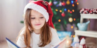 Child reading book at Christmas