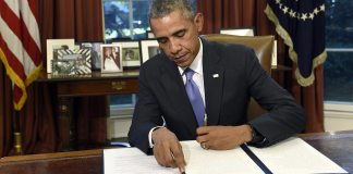 Barack Obama signs law