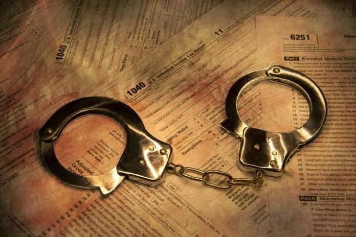 tax fraud handcuffs