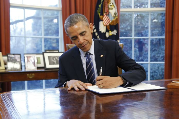 Barack Obama signing law/executive action