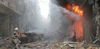 Syrian emergency personnel extinguish a