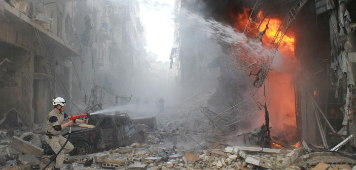Syrian emergency personnel extinguish a