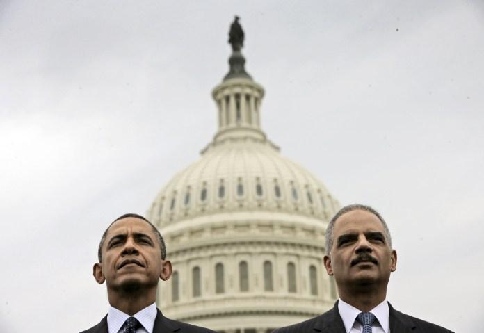 Democrats Obama and Eric Holder