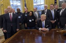 President Donald Trump's opening work day offered a look at his tricky balancing act between American businesses and the working-class voters