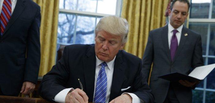 Donald Trump signing