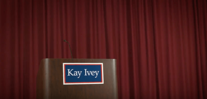 Kay Ivey empty podium