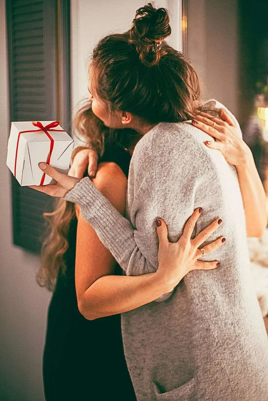 two woman hugging each other