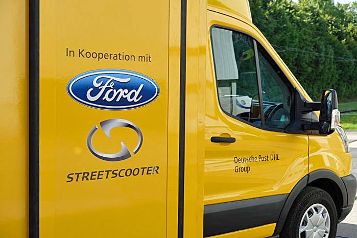Over Fords logo står der 'I samarbejde med', så Ford kan holde en arms længdes afstand til den varme kartoffel