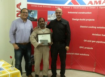 Handing certificates on Workers Seniority Awards, Qatar, 2015