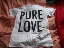 A photo of a Pure Love band t-shirt and the ticket to the gig.