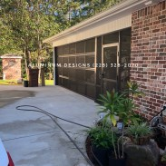 screened garage style door and screen under
