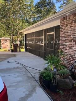 screened garage style door and screen under