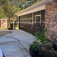 Garage-style screen door Built by Aluminum Designs of Saucier, MS.