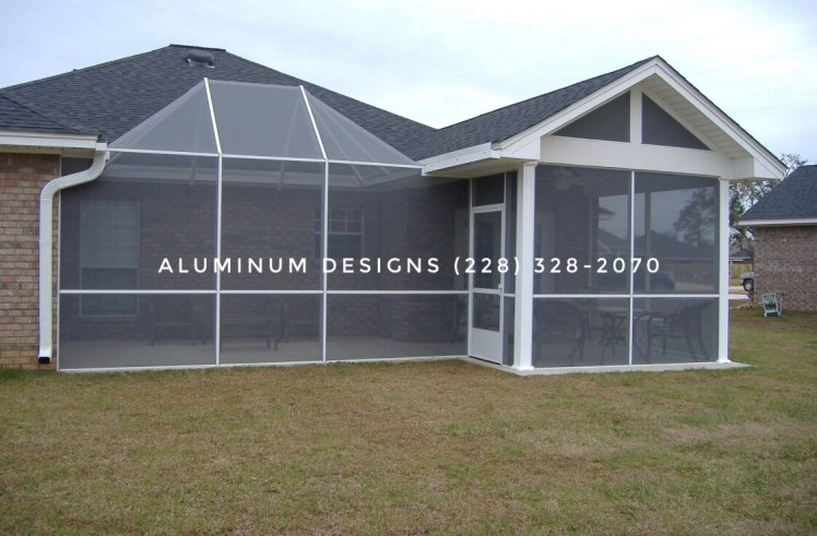 aluminum framed screen enclosure on patio with screen walls under existing shingled patio cover.