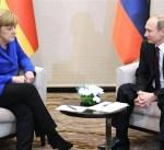 مفوض أوروبي يدعو إلى اجتماع قريب بين ميركل وبوتين لبحث الأزمة السورية