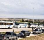 8100 من المسلحين وعائلاتهم يغادرون ريفي حمص وحماة إلى إدلب