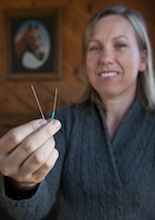 Abby Greiner '96 holds needles used in her acupuncture practice.