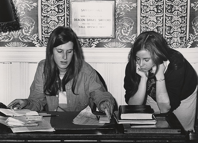 Students at the bell desk in Safford Hall, 1971 Photo courtesy of MHC Archives and Special Collections