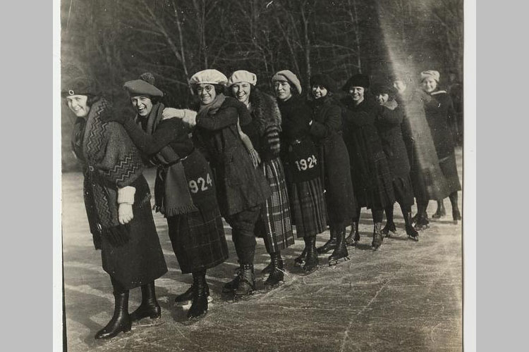 Class of 1924 skates on a campus lake