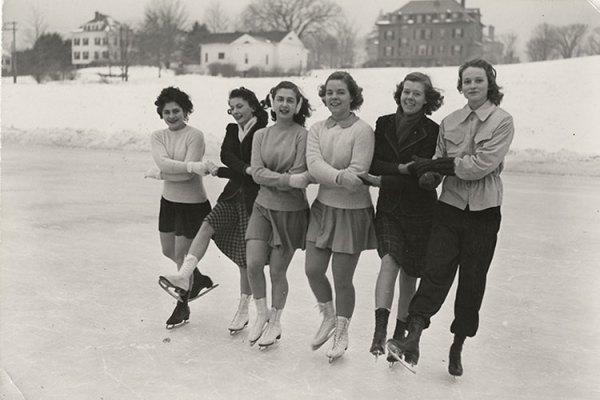 Six students ice skate on Lower Lake, circa 1945–1956.