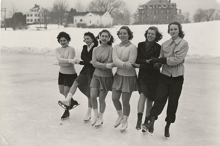 Six students ice skate on Lower Lake, circa 1945–1956.