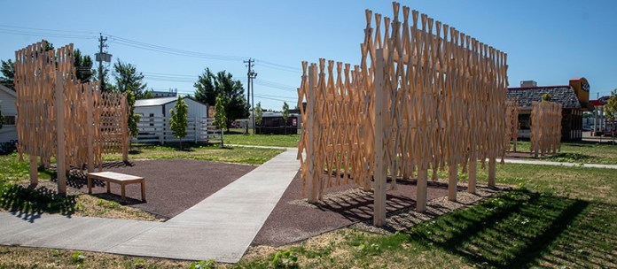 The Walter Hood-designed sculpture is a composition of wood walls that pay homage to the previous homes located on the lot.