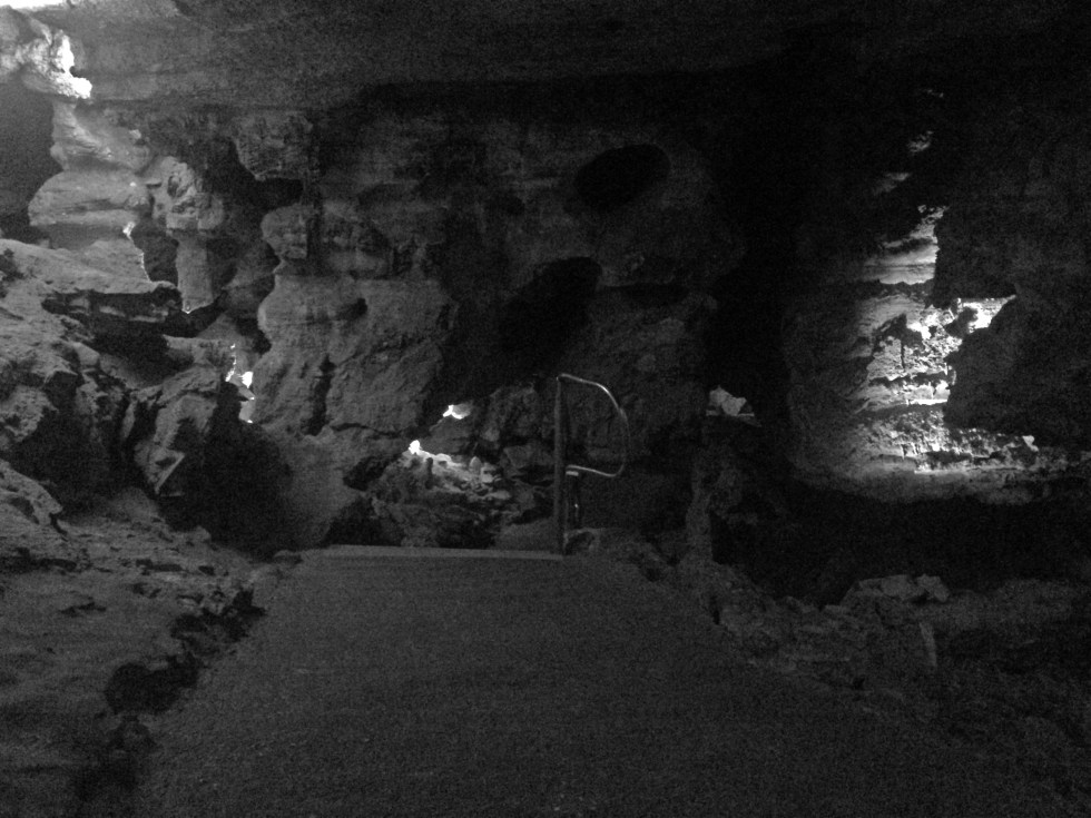 A black and white image inside of the dark caves of Wind Cave National Park