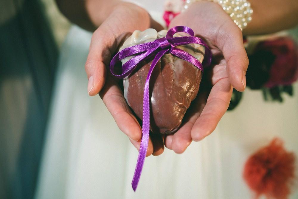 bride holds prosethetic heart