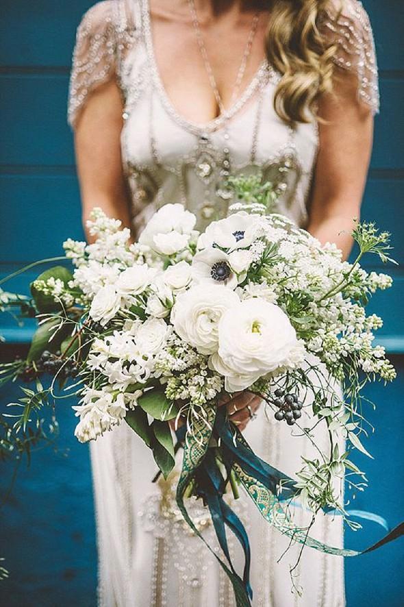 white ranunculas anenome berry jasmine bouquet by McKenzie Powell Photography Kim Smith Miller