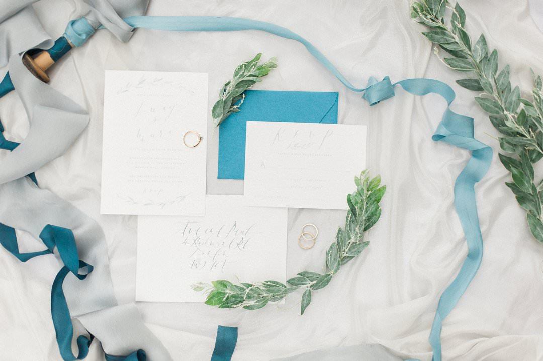 wedding stationery flatlay shades of blue handdyed silks