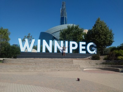 Matt in front of Winnipeg sign