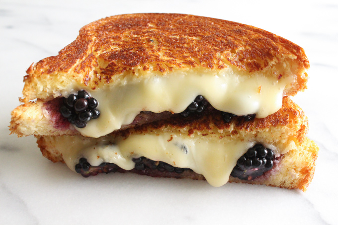 This dessert grilled cheese - with brie, blackberries, and honey grilled between thick slices of brioche - is perfect for dessert or brunch...or any time!
