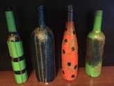 Halloween wine bottles, just waiting to be lit up with Christmas lights