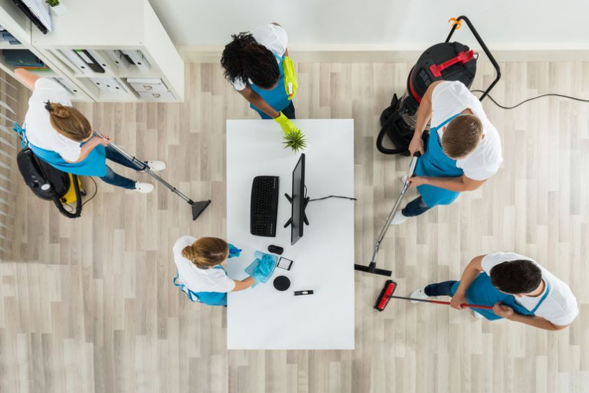 Cleaning The Office With Cleaning Equipments