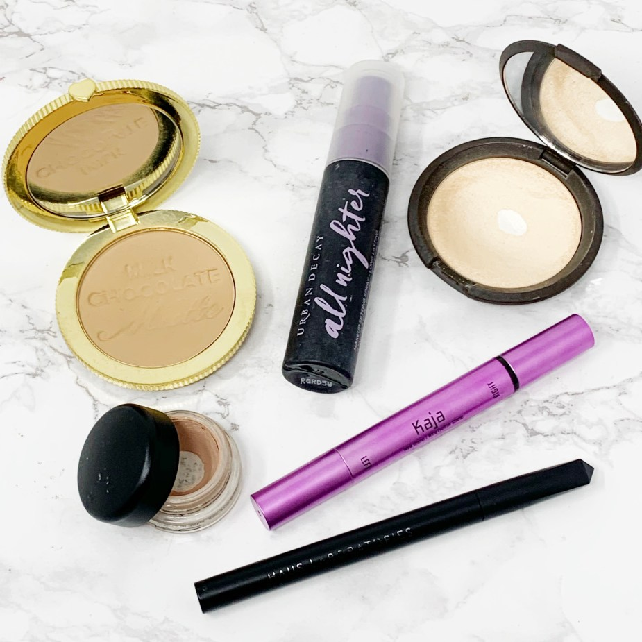 Makeup Necessities - All the basics you need in your makeup bag. Extras - Too Faced Chocolate Bronzer, Becca highlighter, Kaja Wink Stamp Kit, Haus Laboratories Eye-Lie-Ner, MAC Paint Pot, Urban Decay Setting Spray