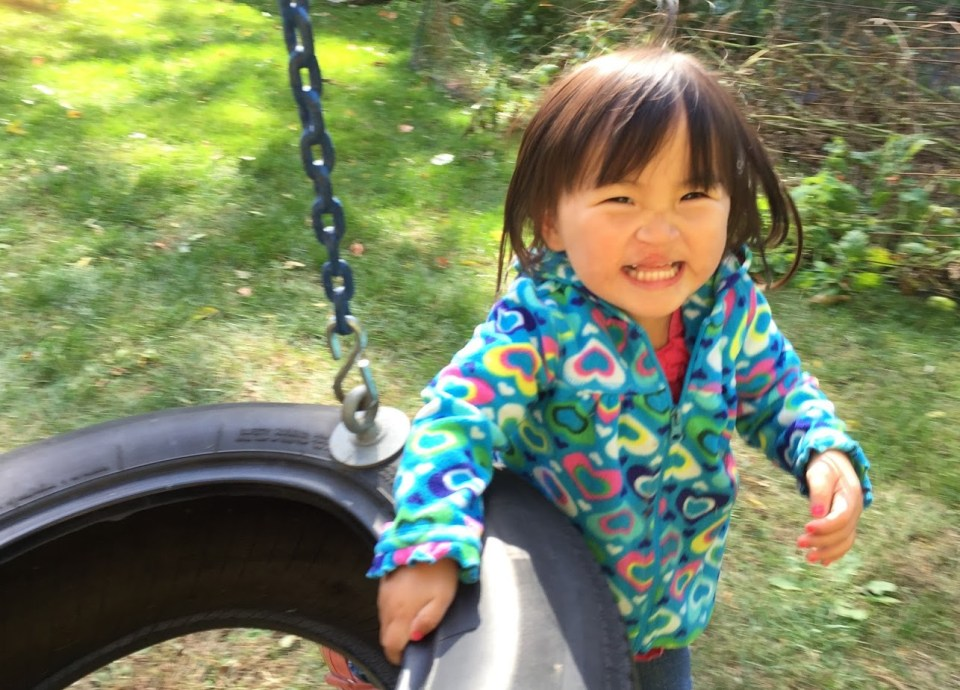 """And the """"mommy's chasing me around the tire swing"""" smile!"""